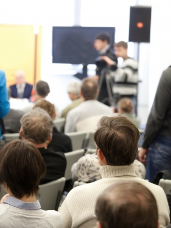 The audience listens to the acting in a conference hall. Stock Photo - 17728735