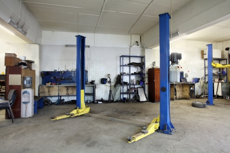 car in garage: Image of a car repair garage Editorial