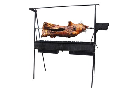 spit: suckling-pig grills on a spit Stock Photo