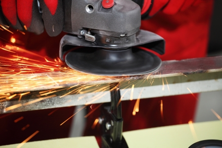 Metall sparks from the grinding machine Stock Photo