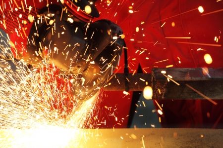 Metall sparks from the grinding machine photo