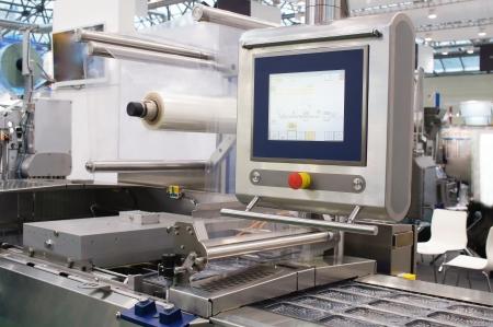 Das Bild von einer Lebensmittelverpackungsindustrie Ausrüstung Standard-Bild