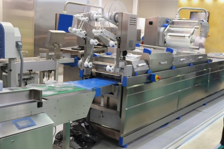 automated tooling: The image of a food packing industry equipment Stock Photo