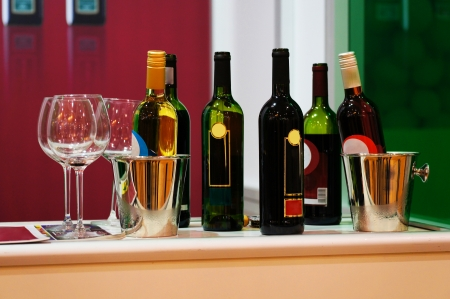 wine bottles on a counter photo