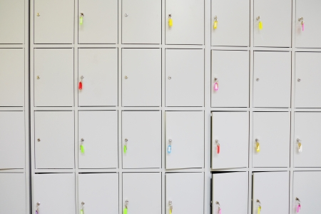 checkroom: Row of the cells in a luggage office or a cloakroom Stock Photo