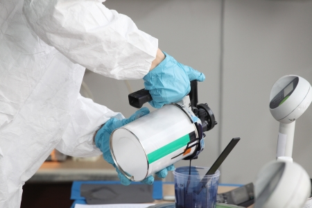 dilute: Preparation of paint for car painting in car body shop laboratory Stock Photo