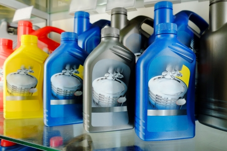antifreeze: Oil in bottles in a shop Stock Photo
