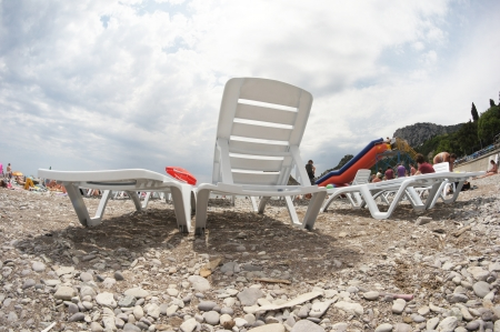 lounges: Chaise lounges on a beach Stock Photo