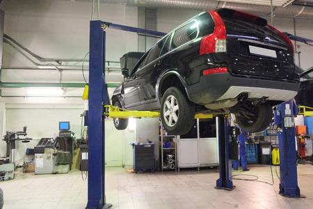 car lift: Image of a car repair garage Editorial