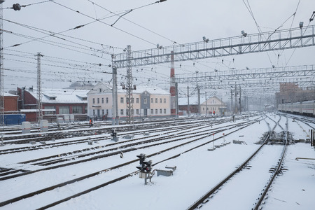 the image of a winter view of the railroad tracks photo