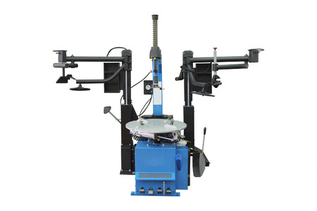 automated tooling: The image of tyre fitting machine under the white background