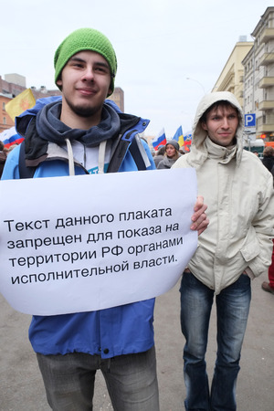 separatism: MOSCOW - MARCH 15: Youmg man shows the transporant during the protest manifestation of muscovites against war in Ukraine and Russias support of separatism in the Crimea, Circular Boulevards in Moscow, Russia on March, 15, 2014.