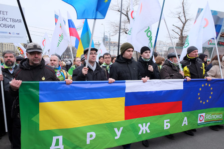 downtrodden: MOSCOW - MARCH 15: Protest manifestation of muscovites against war in Ukraine and Russias support of separatism in the Crimea, Circular Boulevards in Moscow, Russia on March, 15, 2014. It was not the only manifestation in Moscow that day. Just that tine