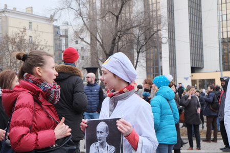 MOSCOW - MARCH 15: Girls with transporant at a time of protest manifestation of muscovites against war in Ukraine and Russias support of separatism in the Crimea, Circular Boulevards in Moscow, Russia on March, 15, 2014. It was not the only manifestation Editorial