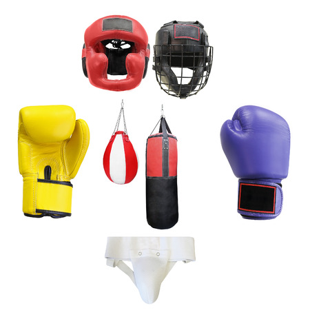 boxing gloves, punching bags and helmets isolated under the white background photo