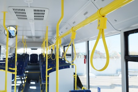 Handles for standing passenger inside a bus photo