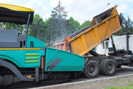 the image of an asphalt spreading machine photo