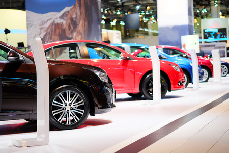 The image of cars in a showroom
