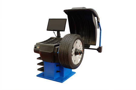 tire fitting: The image of tyre fitting machine under the white background