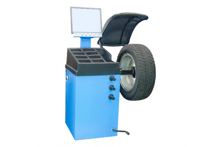 The image of tyre fitting machine under the white background photo