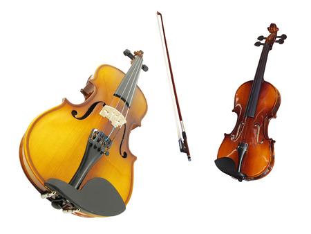 violins: violins and a fiddlestick under the white background