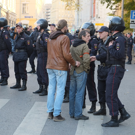 downtrodden: MOSCOW - SEPTEMBER, 21:  Police on a manifestation of muscovites against war in Ukraine and Russias support of separatism in this country, Circular Boulevards in Moscow, Russia on September, 21, 2014.