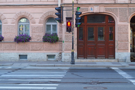 traffic signal: the image of a red traffic light for pedestrians