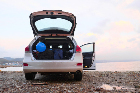 Car with open trunk on a sea coast Stock Photo