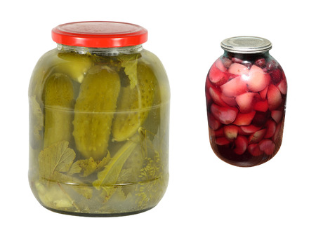 Sweating Jar of Green Cucumbers under the white background photo