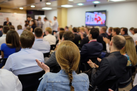 teaching adult: The audience listens to the acting in a conference hall