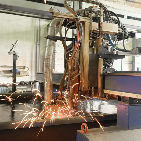 image of a  machine for the laser cutting  metal in water photo