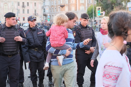 MOSCOW - SEPTEMBER, 21:  Police on a manifestation of muscovites against war in Ukraine and Russias support of separatism in this country, Circular Boulevards in Moscow, Russia on September, 21, 2014.