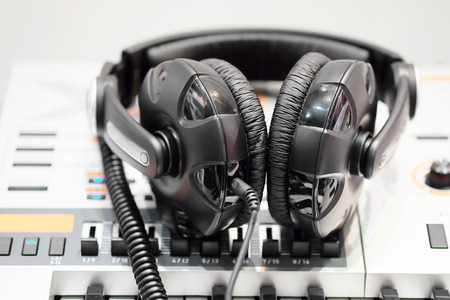 handsfree telephones: headphones isolated under the light background Stock Photo