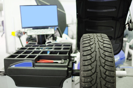 tire fitting: image of tyre fitting machine under the white background