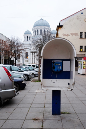 michael the archangel: Payphone under the St. Michael Archangel church in Kaunas, Lithuania. Stock Photo