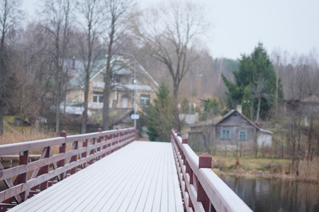 bridge over water: image of a wooden bridge for pedestrians