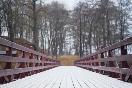 bridge over water: image of a wooden bridge for pedestrians