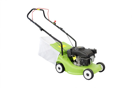 lawn mowing: lawn-mower isolated under the white
