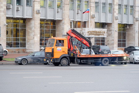 parking violation: Moscow, Russia, December, 18, 2014: Car tow on the streets of Moscow