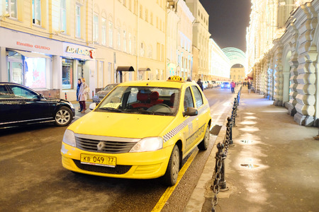 sectoring: Moscow, Russia, December, 18, 2014: yellow taxi in Moscow