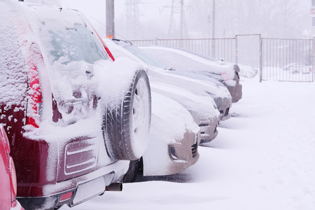 car in the parking lot under the snow photo