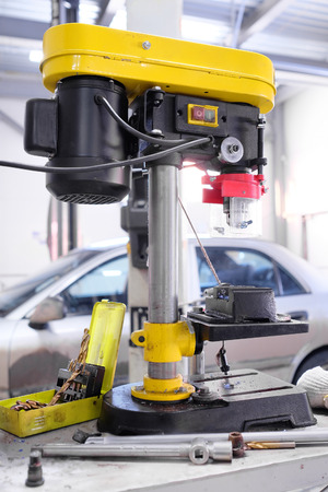 automated tooling: drilling machine in the service station Stock Photo