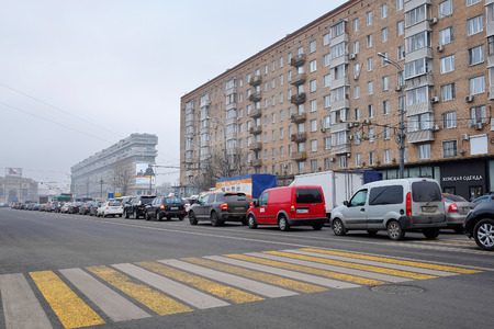 str: Moscow, Russia, November, 25, 2014: Cars stands in traffic jam on Lusinovscaya str. in Moscow, Russia Editorial