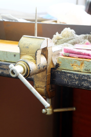 vice: the image of a vice on a metal workbench
