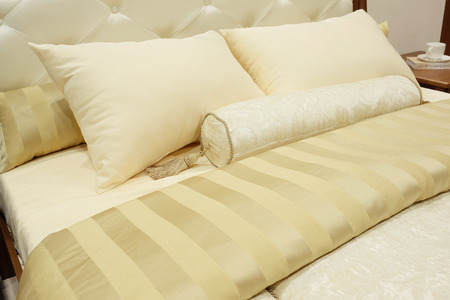 bolster: closeup of two pillows and bolster