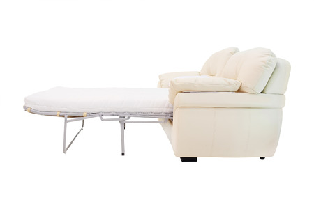 sofa is decomposed in a bed on a white background photo