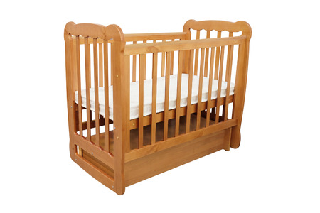 cot: baby cot isolated under the white background