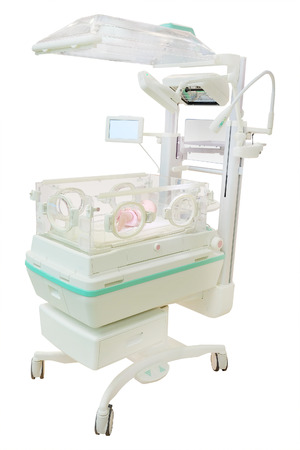 incubator: infant incubator isolated under the white background Stock Photo