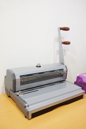 The image of a bookbinding machine. Stitcher Stock fotó