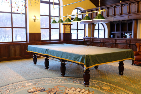 pool room: Covered pool table in the billiard room